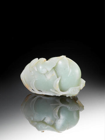A celadon jade group of two peaches 18th century
