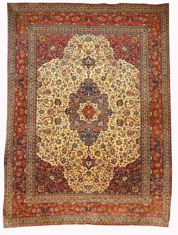 An Isfahan carpet, Central Persia, circa 1930, 413cm x 305cm (13ft 7in x 10ft) some minor wear in main field