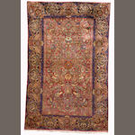 A Kashan silk rug, Central Persia, circa 1890, 203cm x 132cm (6ft 8in x 4ft 4in) excellent condition, minor damage to fringes at one end