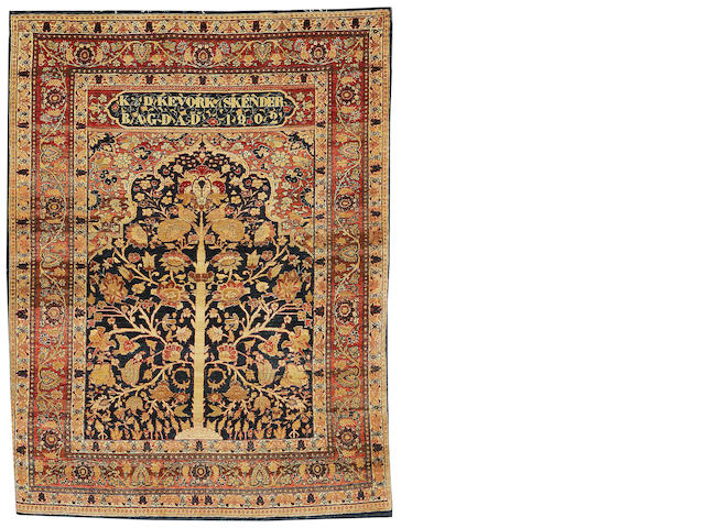 An Iraq rug, Baghdad, circa 1902, 185cm x 140cm (6ft 1in x 4ft 7in) selveges rebound