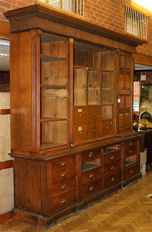 A large late Victorian oak shop/office style bookcase cabinet