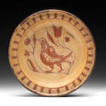 A slipware dish with bird and tulip decoration