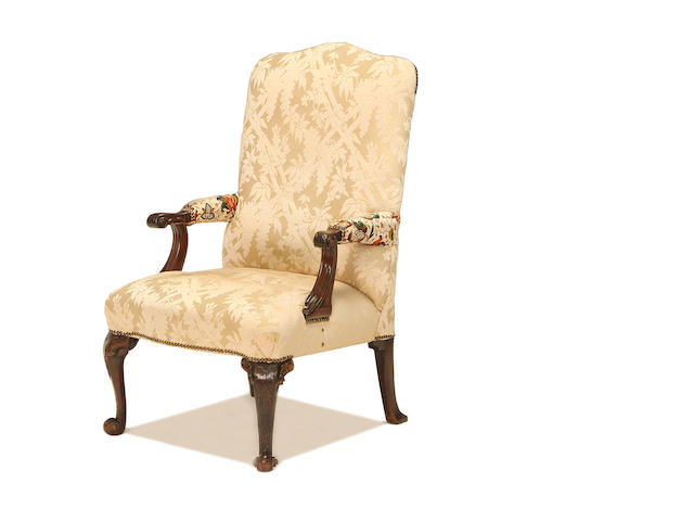 A George III carved mahogany open armchair