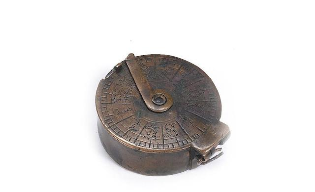 A small brass pocket compass case