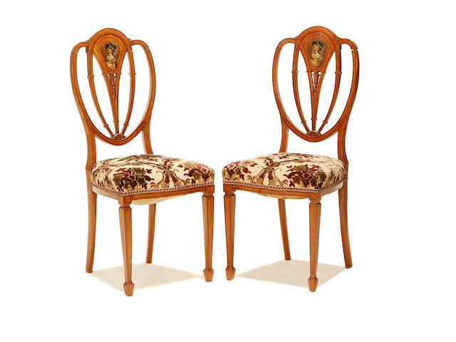 A pair of Edwardian satinwood and polychrome painted side chairs In the Sheraton Revival style