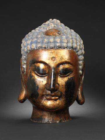 A large giltwood head of the Buddha, probably 18th century