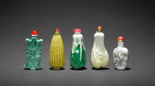 Five various Chinese porcelain snuff bottles; each bottle with a stopper