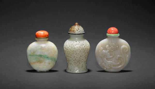 Three Chinese snuff bottles, including: one in jade with a reticulated design; and another in jade decorated with a mytholgical animal