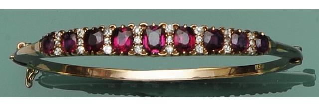 A ruby and diamond hinged bangle