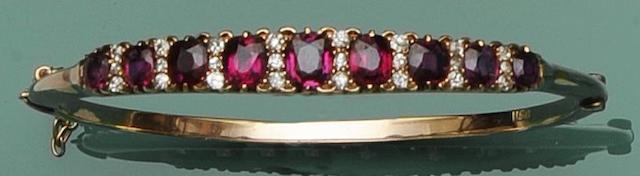 A ruby and diamond hinged bangle