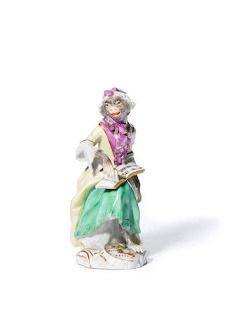 A Meissen money band figure of a seated female singer, third quarter 18th century