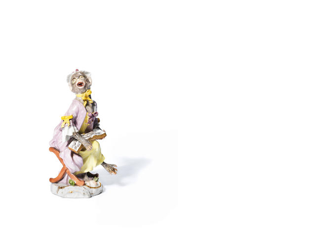 A Meissen monkey band figure of a seated female singer, thirs quarter 18th century