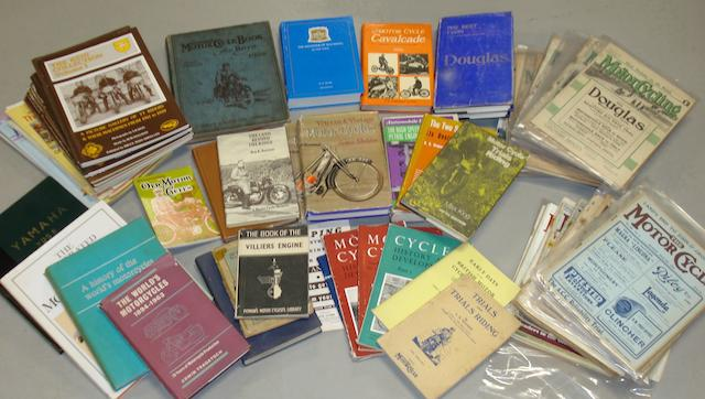 Assorted motorcycle books and literature,