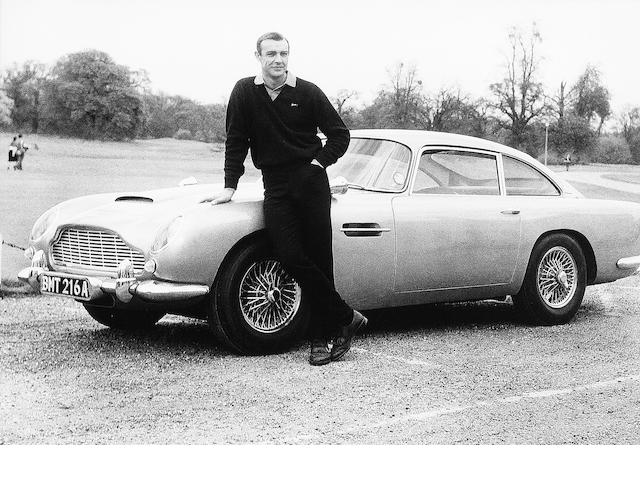 Sean Connery as James Bond alongside his Aston Martin DB5,
