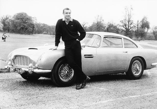 Sean Connery as James Bond alongside his Aston Martin DB5,