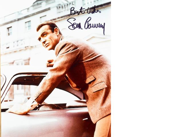 Two signed Sean Connery and Aston Martin DB5 photographs,