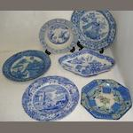 A set of six early 19th Century English pearlware plates, transfer printed in blue in the Oriental palette with a peacock and other birds amongst flowering plants, 25cm, a Spode shaped oval dish, transfer printed in blue with a Willow pattern scene and six other various plates. (13)