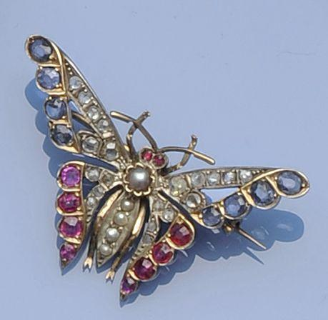 A multi-gem set butterfly brooch