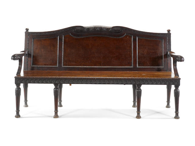 A late 19th century carved mahogany hall bench retailed by H.Samuel, Oxford St, after a design by William and John Linnell