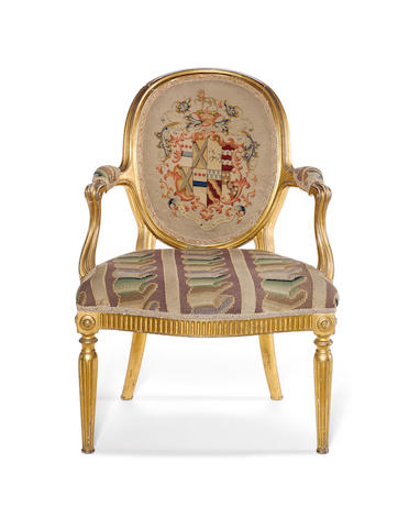 A set of six George III carved giltwood open armchairs in the Louis XVI taste