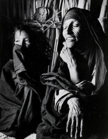 George Rodger (British, 1908-1995) Tuareg Matriarch near Tamanrasset, Algerian Sahara, 1957 Paper 37.8 x 29.6cm (14 7/8 x 11 5/8in), image 28.9 x 22.2cm (11 3/8 x 8 3/4in).