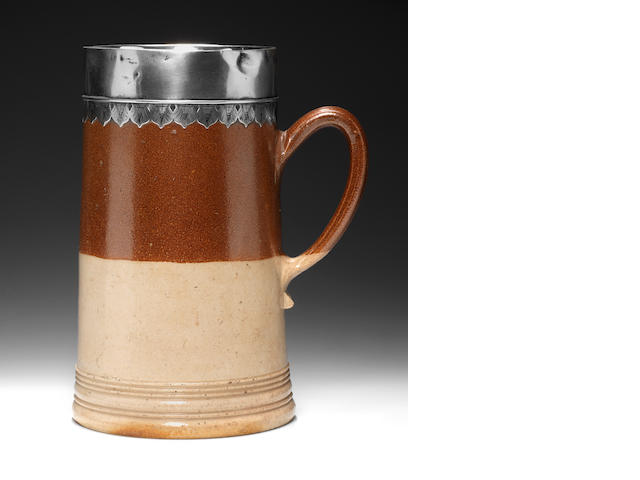 A London stoneware tankard with silver mount stamped with maker's mark MP
