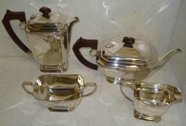 A four piece silver tea service, J B Chatterley & Sons, Birmingham 1973, of canted corner rectangular form with an upper frieze of gadrooning centred by shells and leaves, 58ozs.