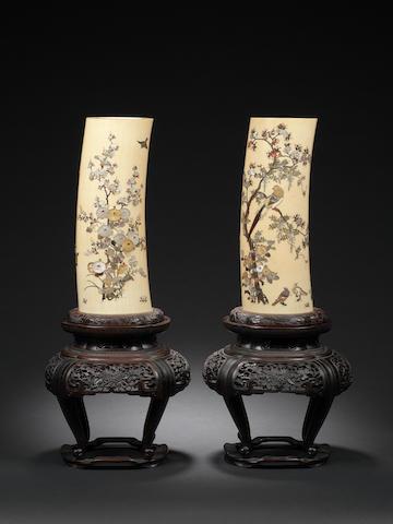 A pair of Shibayama style ivory tusk vases Meiji Period