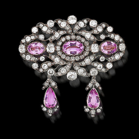 A pink topaz and diamond brooch, (3)
