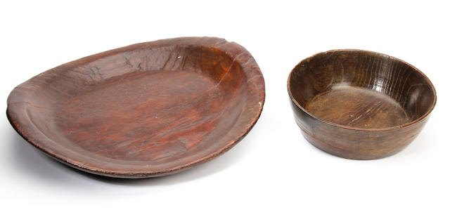 A 19th century turned elm plater and a bowl,