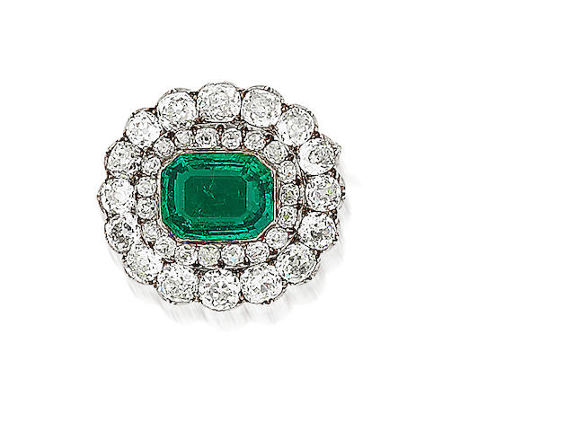 An emerald and diamond cluster brooch,