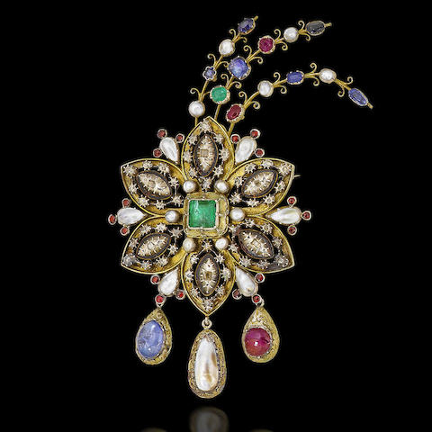 A 19th century gilt metal and multi gem-set ornamental brooch