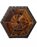 A mid 19th century Singhalese specimen wood and carved ebony occasional table