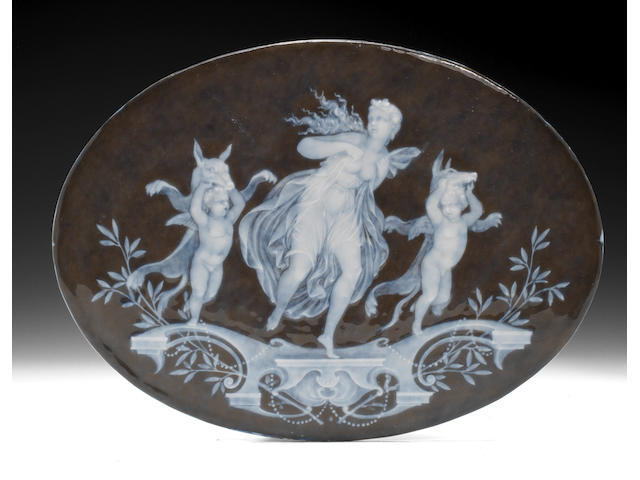 A French oval pâte-sur-pâte plaque by Solon, Cupids in Wolf's clothing