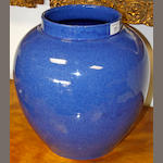 A Moorcroft jar, of large size, 1929, glazed in specked powder blue monochrome glaze, signature to base painted date 1929, paper label 'Potters To Her Majesty The Queen', 36cm.