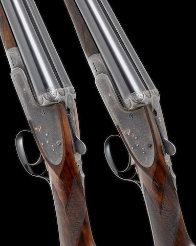 A fine pair of 12-bore single-trigger sidelock ejector guns by James Woodward & Sons, no. 5816/7 In their brass-mounted oak and leather case