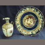 Three Continental majolica plates, and a pair of jugs, metal mounts, Taylor Tunnicliffe (one a/f)