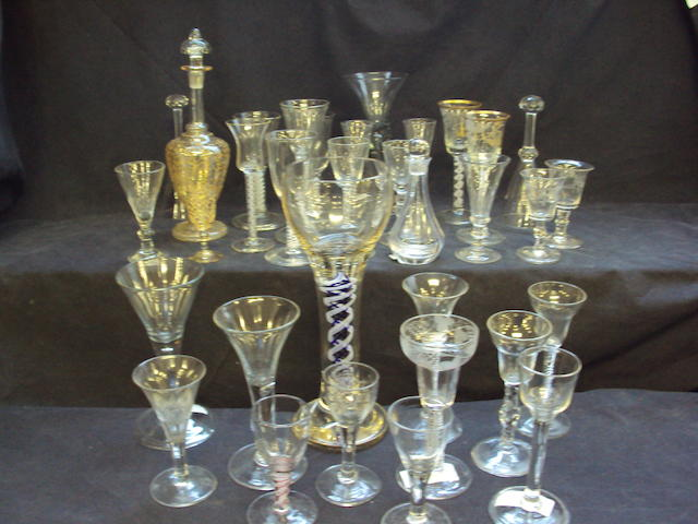 A large collection of wine glasses and goblets