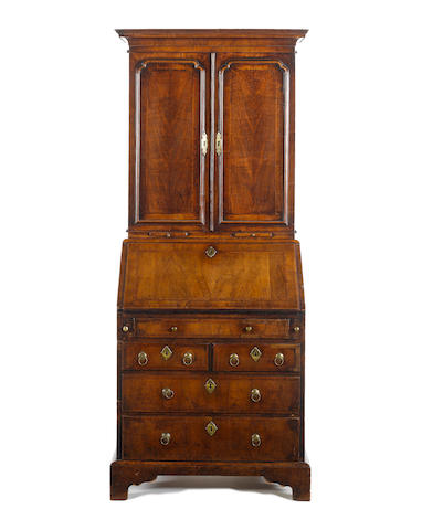 A walnut crossbanded and featherbanded child's bureau bookcase