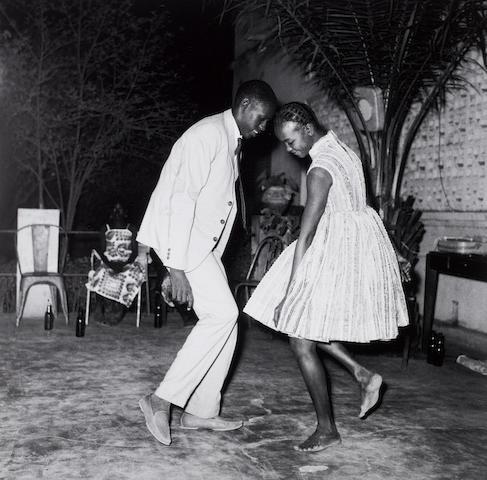 Malick Sidibé (Malian, born 1936) Nuit de Noël (Happy-club), 1963 Paper 60.6 x 50.2cm (23 7/8 x 19 3/4in), image 42.6 x 42.8cm (16 3/4 x 16 7/8in).