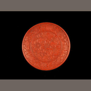 A red lacquer carved saucer dish 16th century, probably Jiaqing