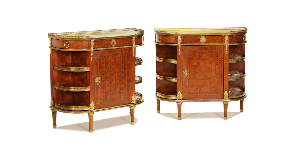 A pair of French late 19th Century kingwood and parquetry cabinets