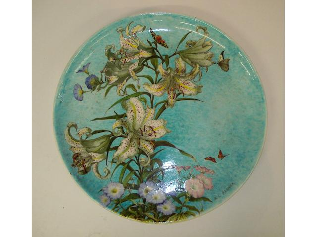 A large Theodore Deck faience 'Lilium' wall charger by A. L. Regnier  Circa 1910