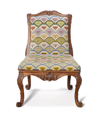 A George II carved walnut side chair in the French taste