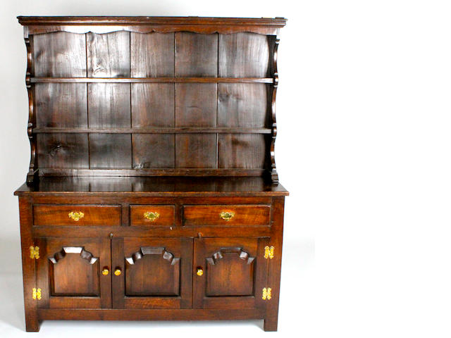 A reproduction, 18th century style, oak dresser and rack
