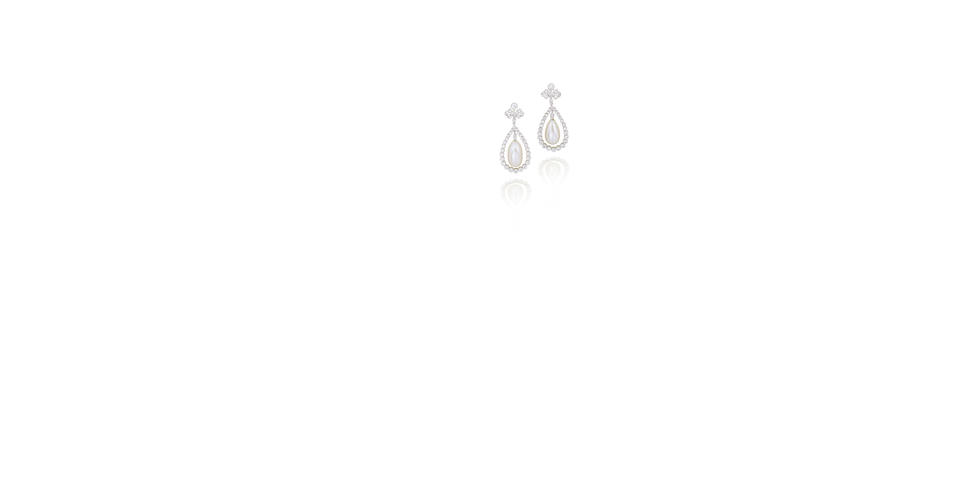 An important pair of natural pearl and diamond earrings