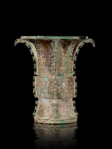 A rare archaic bronze ritual wine vessel, zun  Early Western Zhou Dynasty, Circa BC 1050-900