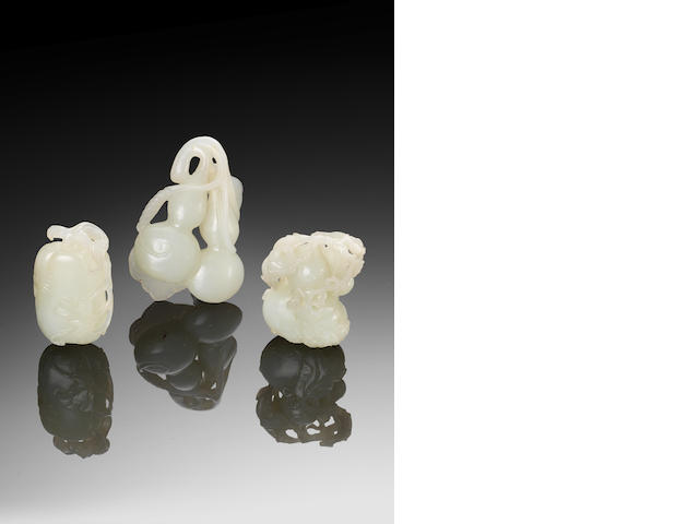 Three white jade double-gourd and melon carvings 18th/19th century