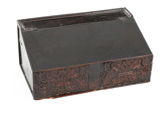 A late 17th Century carved oak boarded desk box