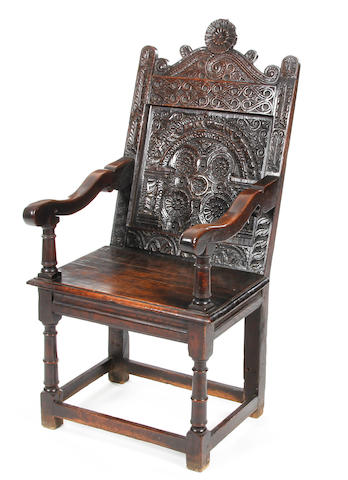 A Charles I oak panel back open armchair Possibly Somerset